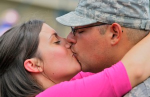 20090529TK 4/x Jessica Geronimo of Allenhurst gives her boyfriend Jorge Morejon of the New Jersey National Guard 50th Infantry Brigade Combat Team a long kiss after he retunrd this morning to Fort Dix after a year in Iraq. The two continued to kiss like this for 10 minutes as other soldiers greeted their family members around them. FORT DIX, NJ 5/29/09 2:28:57 PM TONY KURDZUK/THE STAR-LEDGER