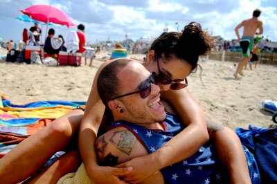 Grace Sabbagh, from Washington Twp. and Jose Ortiz, from Philidelphia, enjoy relaxing on the Belmar Beach Thursday afternoon. People enjoy the nice weather on the 4th of July holiday. (Aristide Economopoulos/The Star-Ledger)